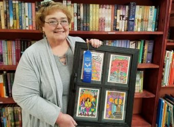 Bernadette Hocking with her First Prize Pumpkin Show Colored Cards at Keystone Books