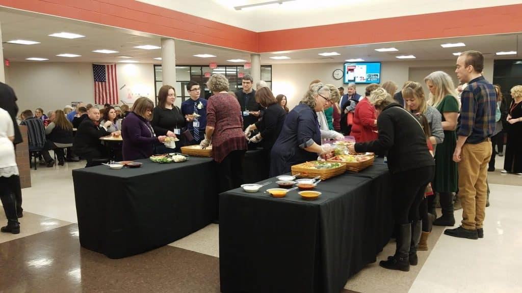 Guests Line Up for Food in Circleville Middle School Cafeteria