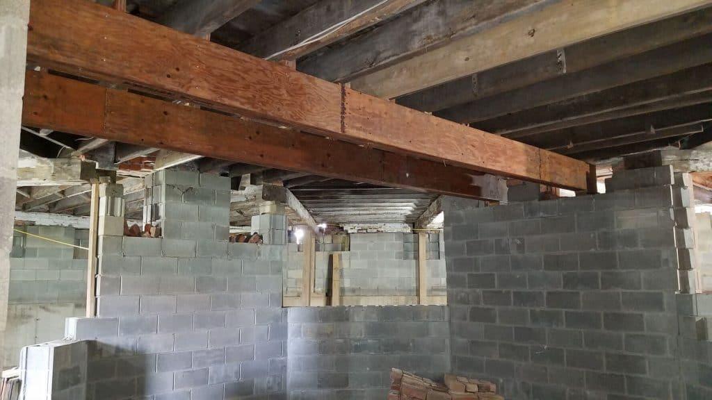 Beams reinforced floor basement