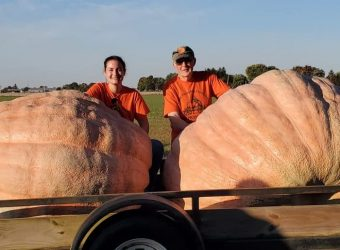 Bob and Bella Liggett with their Giant Pumpkins