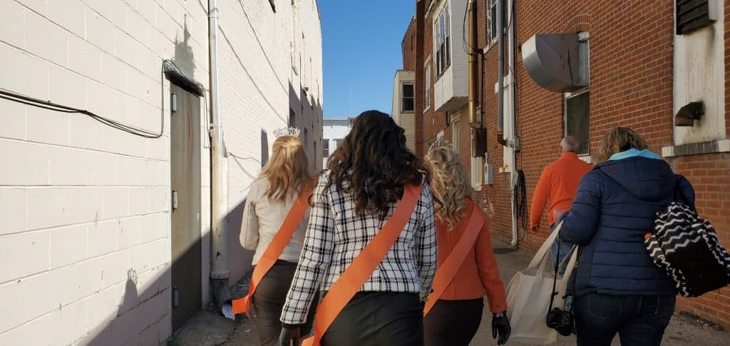 Miss Pumpkin Show and her Court walking to Lindsey's Bakert