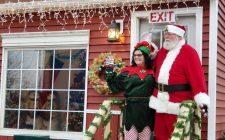Santa Claus and his helper at the Santa House in the Pumpkin Show Park