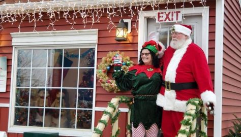 Santa Claus and his helper at the Santa House in the Pumpkin Show Park
