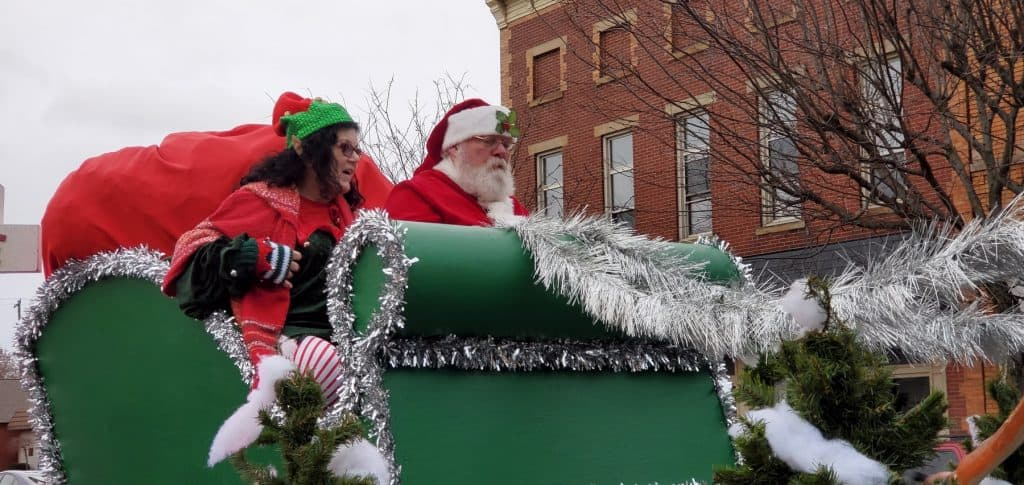 Santa Claus riding in his sleigh during the Round Town Christmas Parade