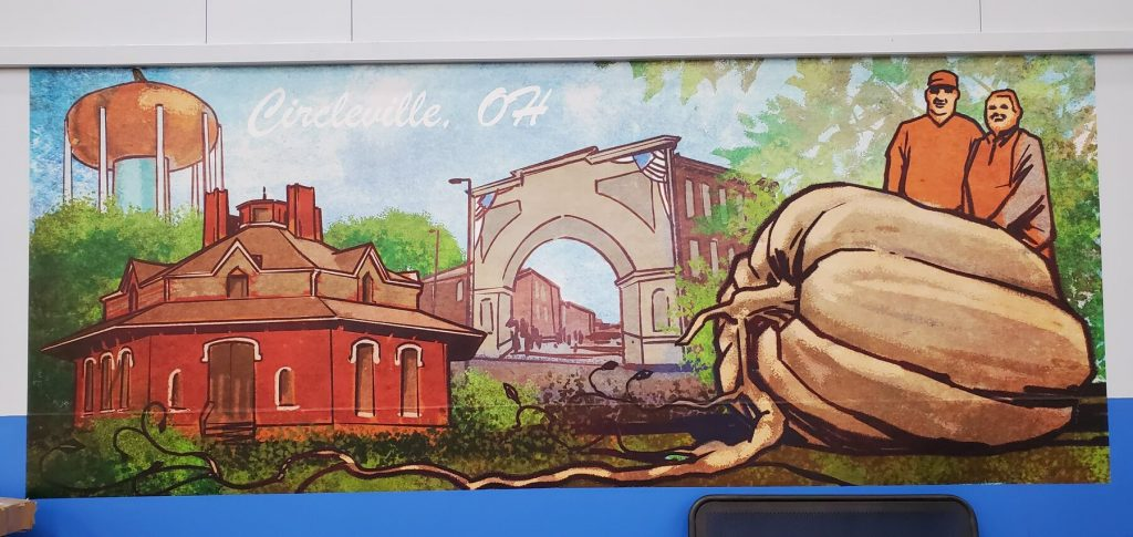 Local chain store installs mural with iconic local landmarks