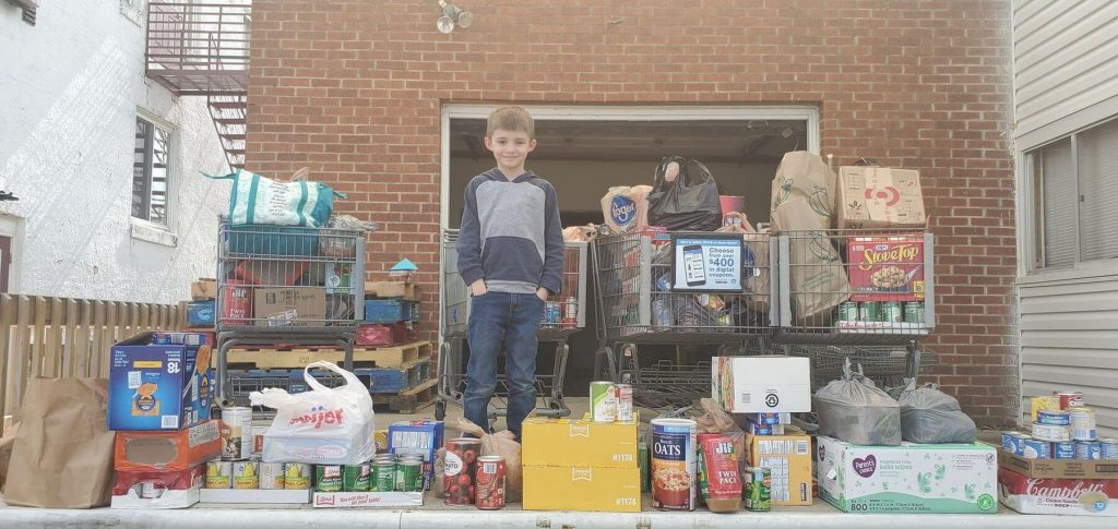 Local boy donates food raised during birthday food drive