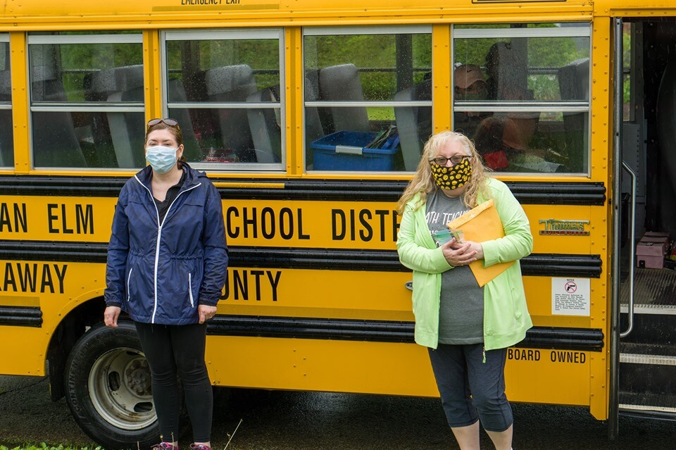 Mrs McKibben and a teacher on the farewell bus tour
