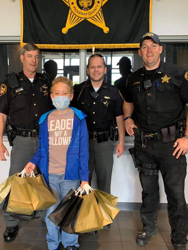 Young boy gives gift bags to Pickaway County Sheriff's Office